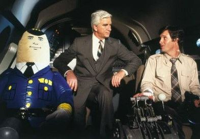 Or you could talk to the guy next to you (Airplane! Paramount Pictures)